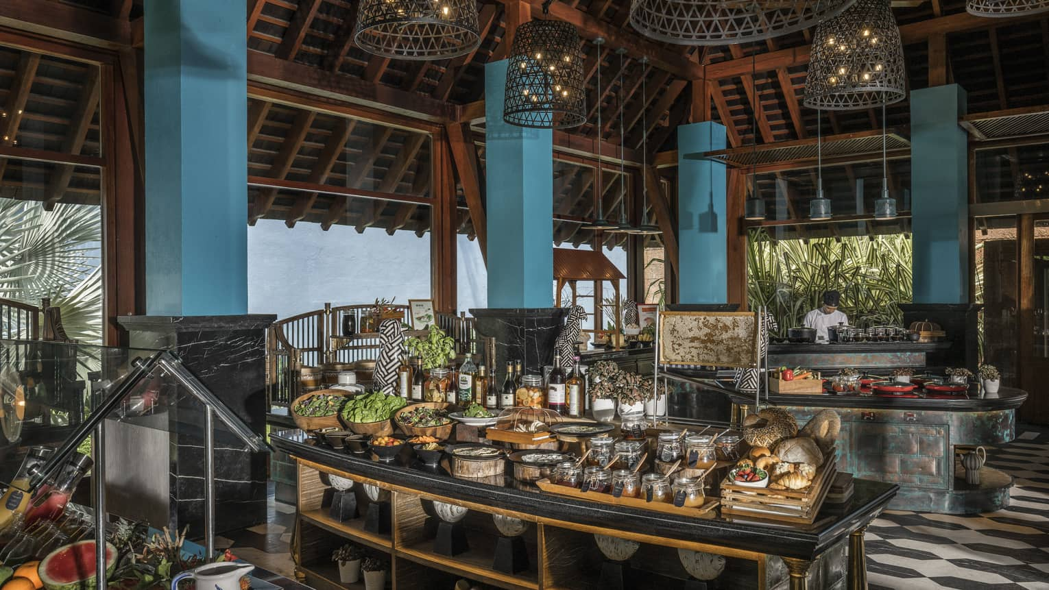 Lower Serai Restaurant Buffet with a chef cooking and fresh fruit