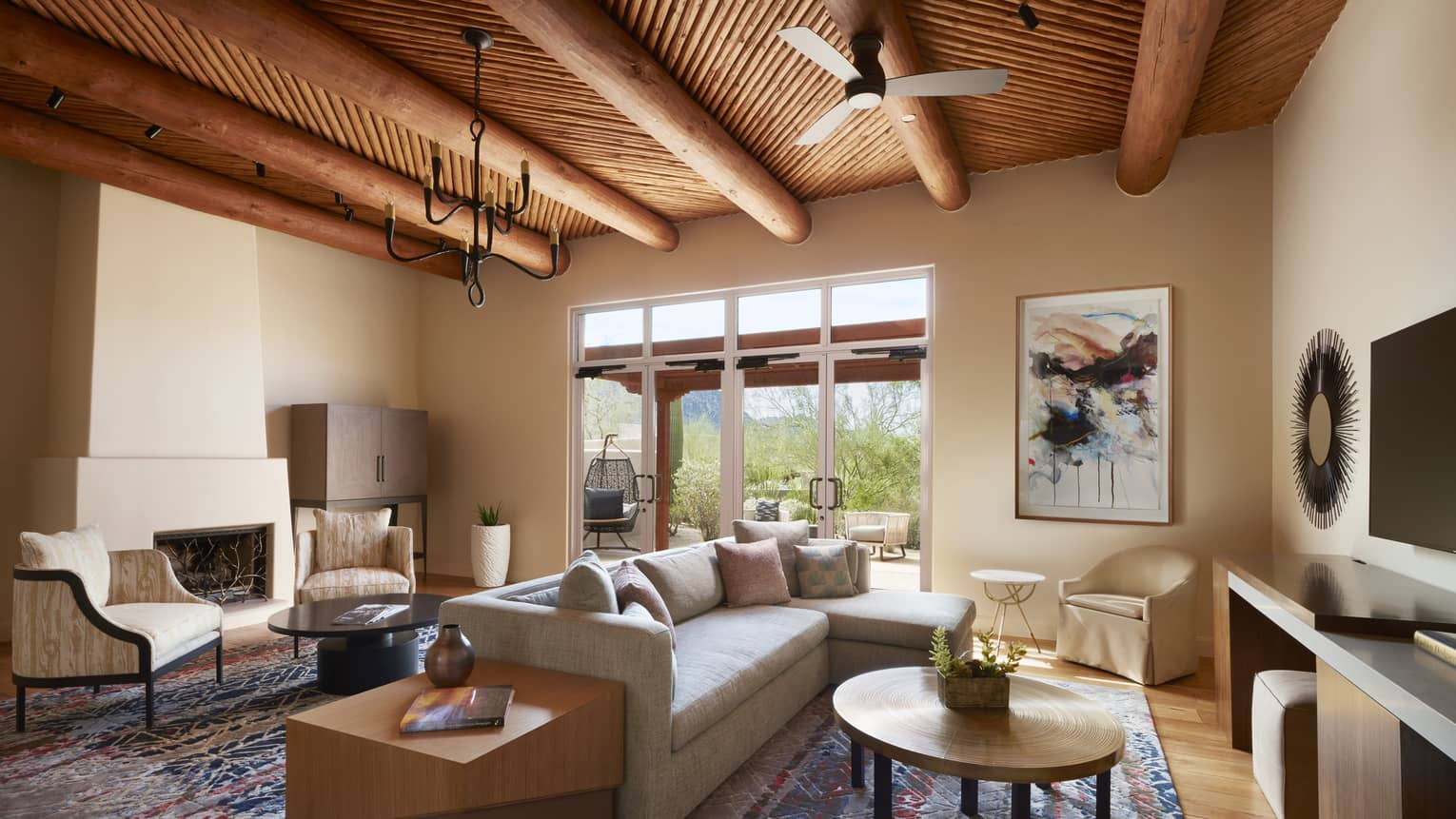 Prescott Suite seating areas under beam ceiling with small fan