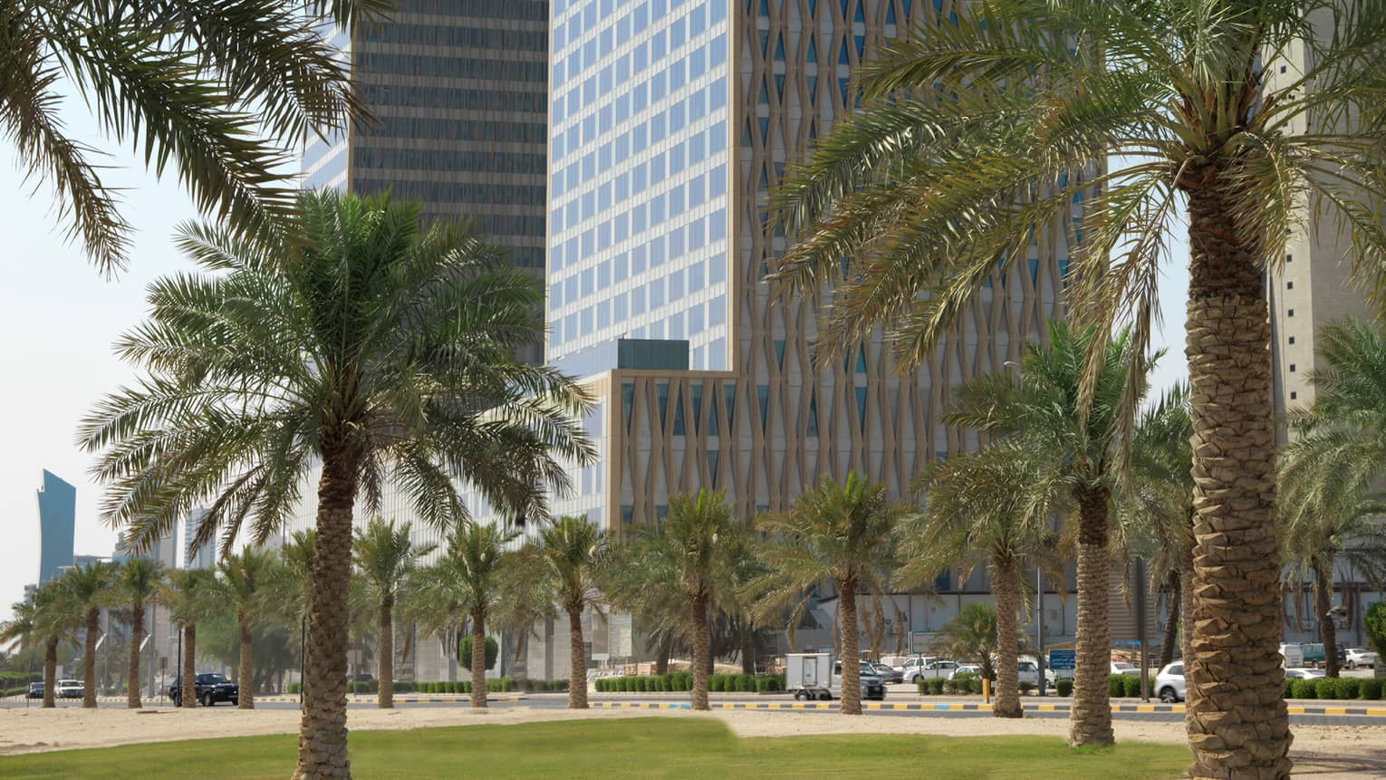 Four Seasons Hotel Kuwait exterior, high rise building with Arabic design