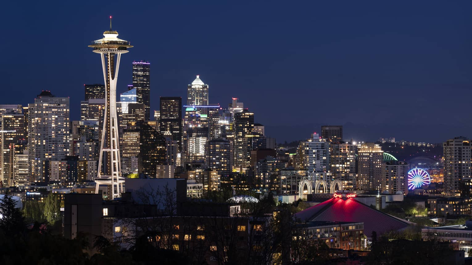 The city of Seattle and the Space Needle are illuminated at night