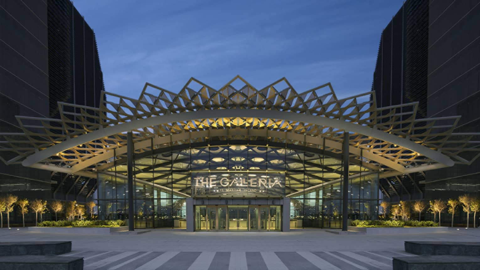Galleria Mall entrance with sign and exterior with elaborate modern awning at dusk