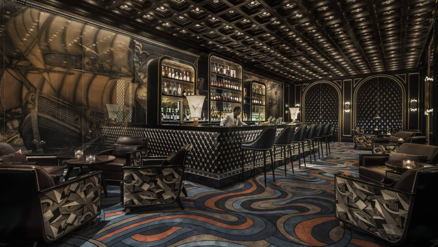 Nautilus Bar with blue-and-orange ocean-like swirled carpet, ship mural on wall, bartender behind bar