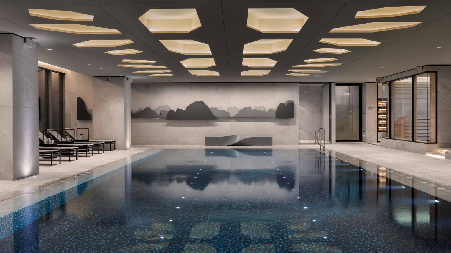 Indoor swimming pool under ceiling with recessed lights