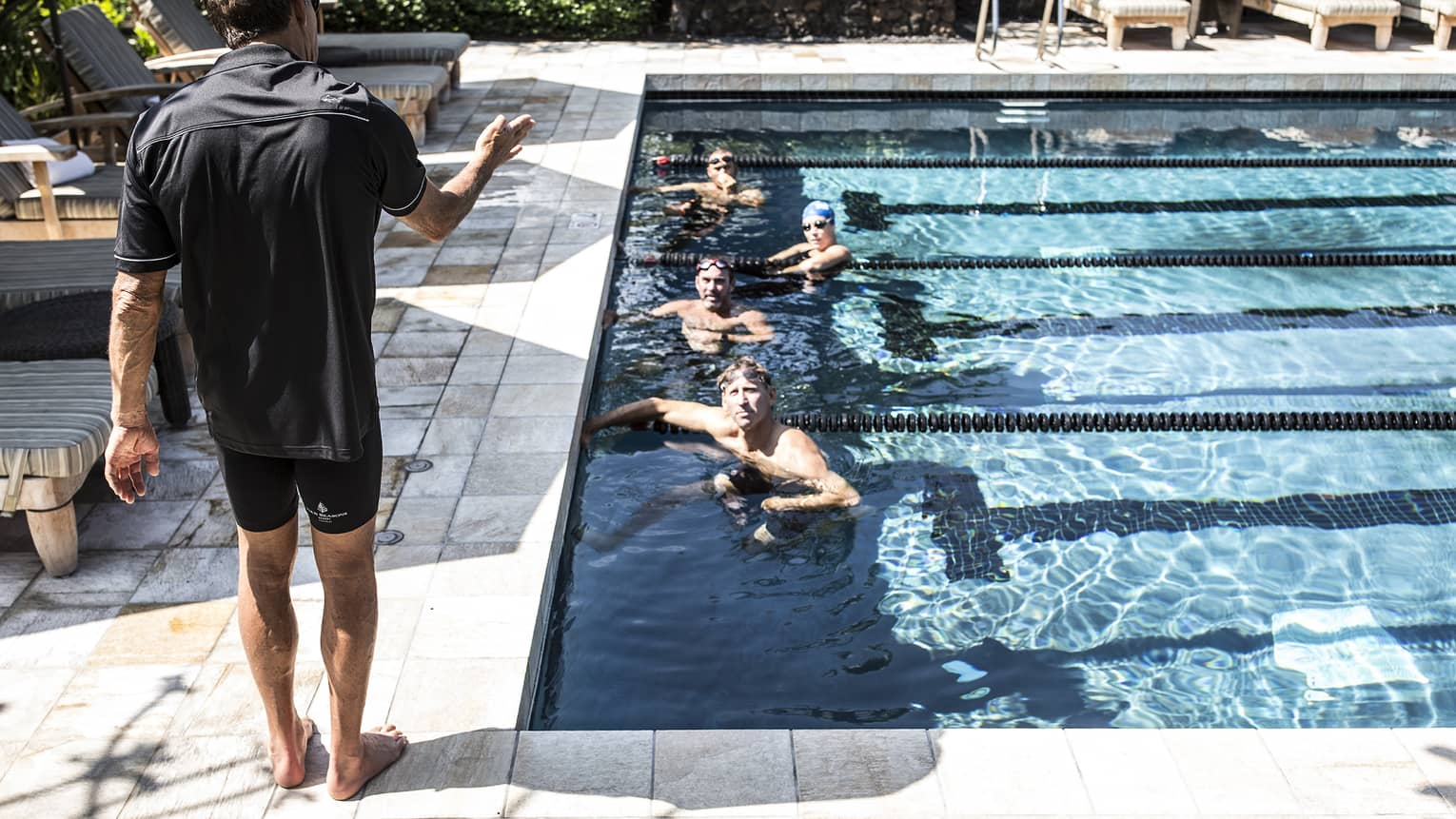 Guests in a pool, training for a triathlon with Dave Scott