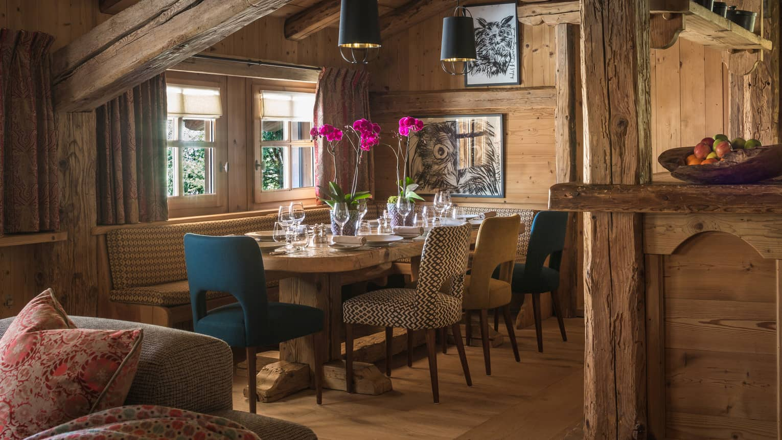 Private dining table, chairs and cushioned banquette in timber kitchen