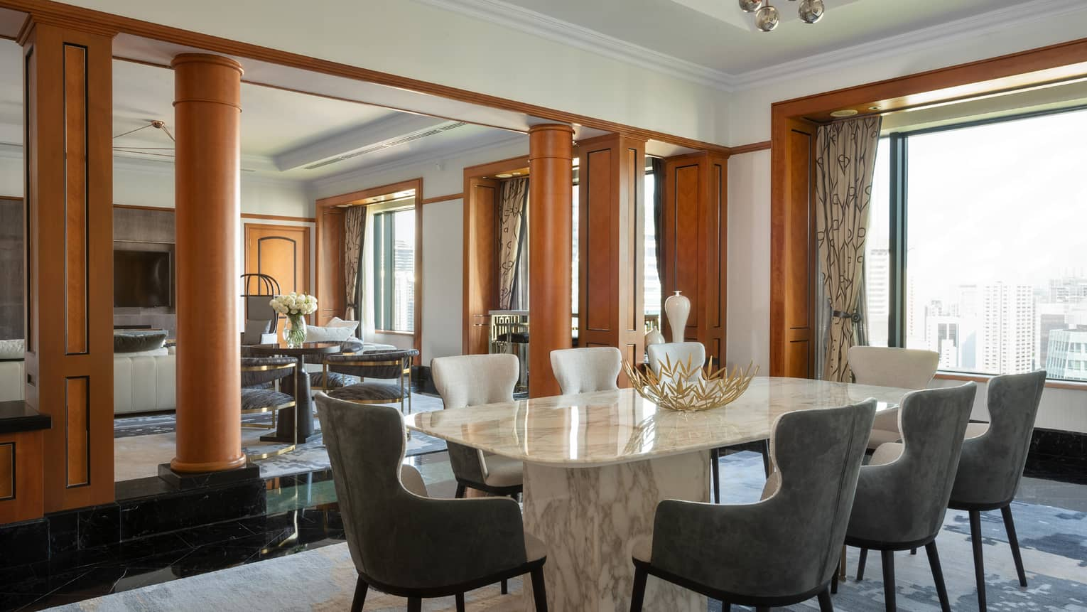 Presidential suite dining area with marble table and floor-to-ceiling windows