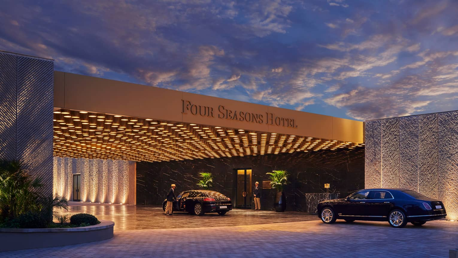 Modern Four Seasons Hotel Casablanca entrance at nights with lights, luxury cars