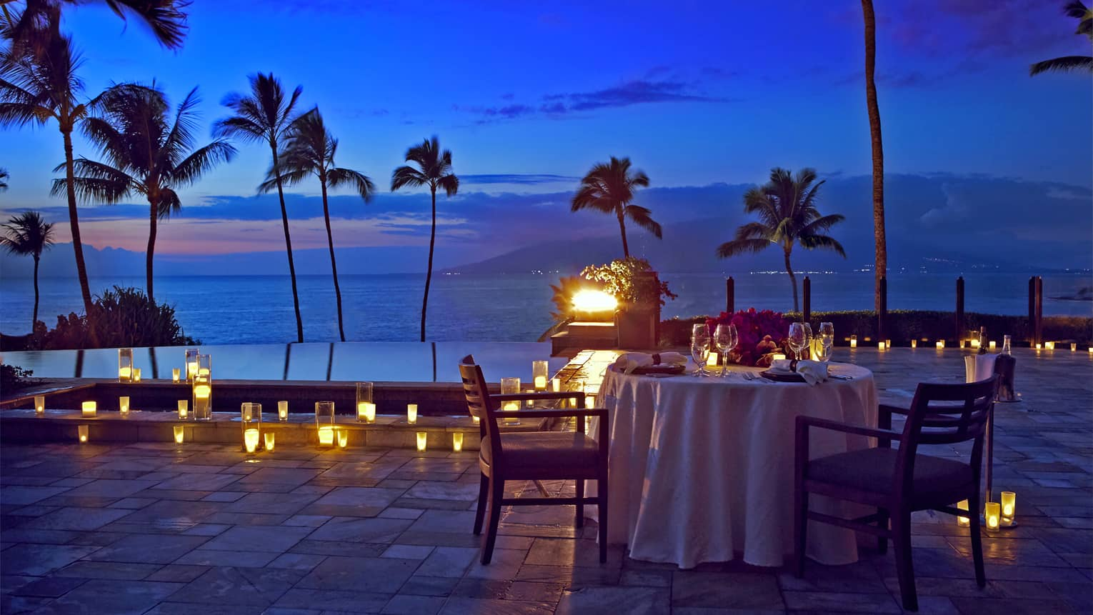 An outdoor candlelit dinner by the seaside in Maui