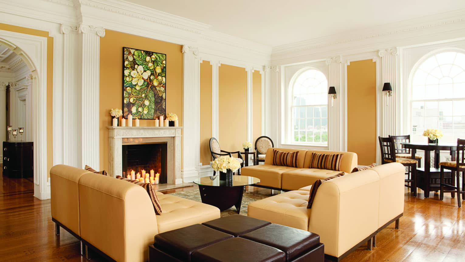 Tan sofas around fireplace in modern Royal Suite Living Room