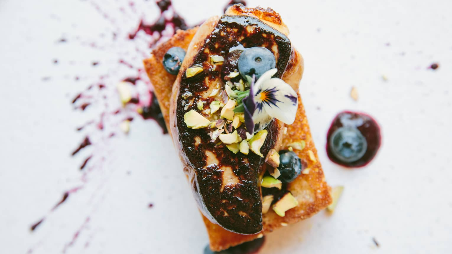 Hudson Valley foie gras delicately topped with blueberries, cashews and a flower