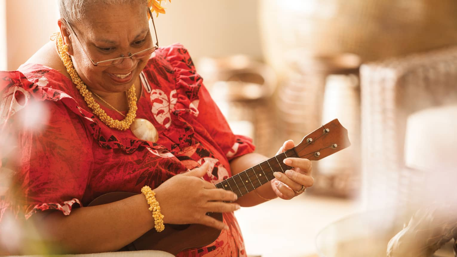 Close-up of Hawaiian elder playing ukulele