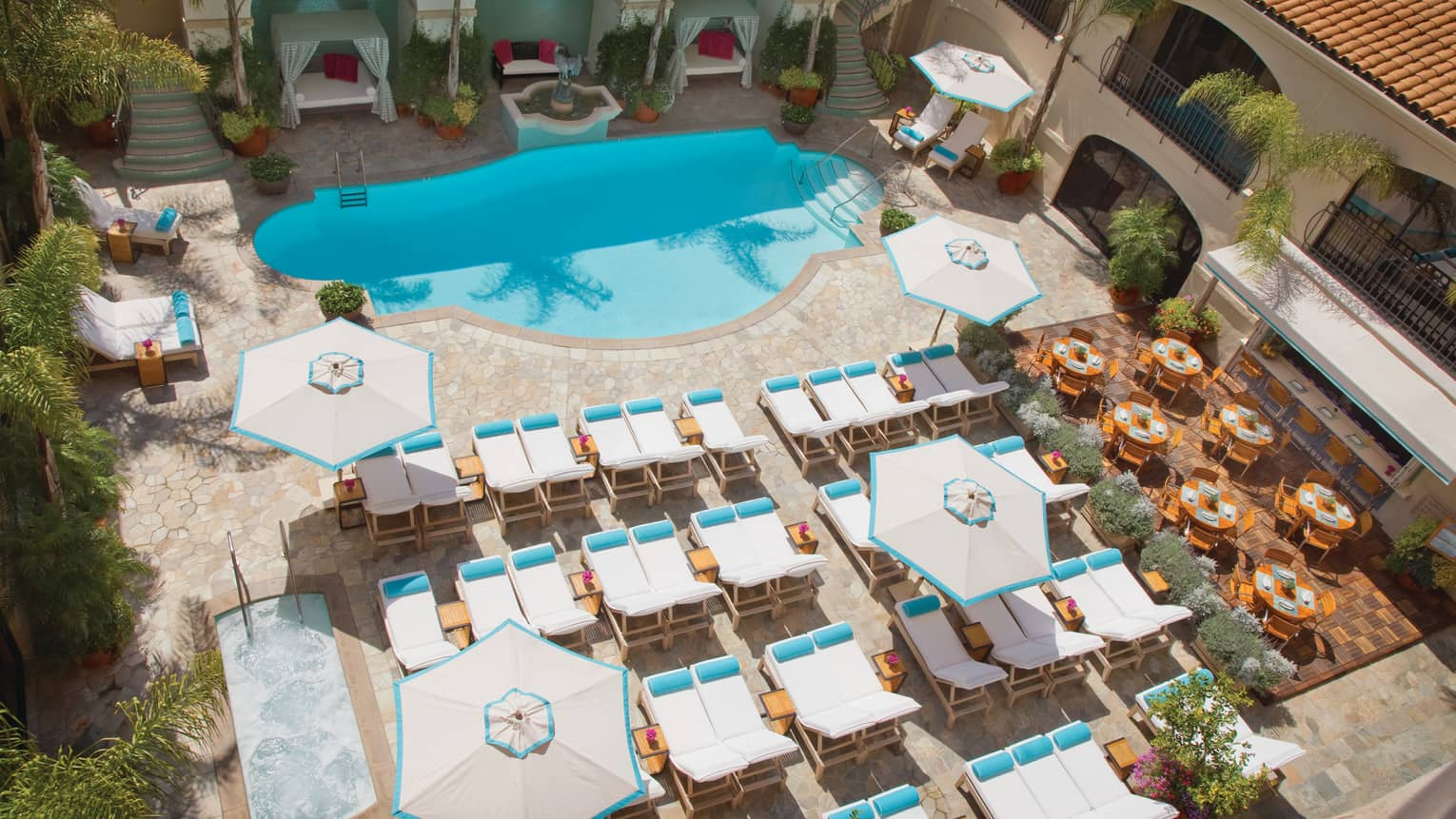 Aerial view of white pool chairs, blue outdoor swimming pool