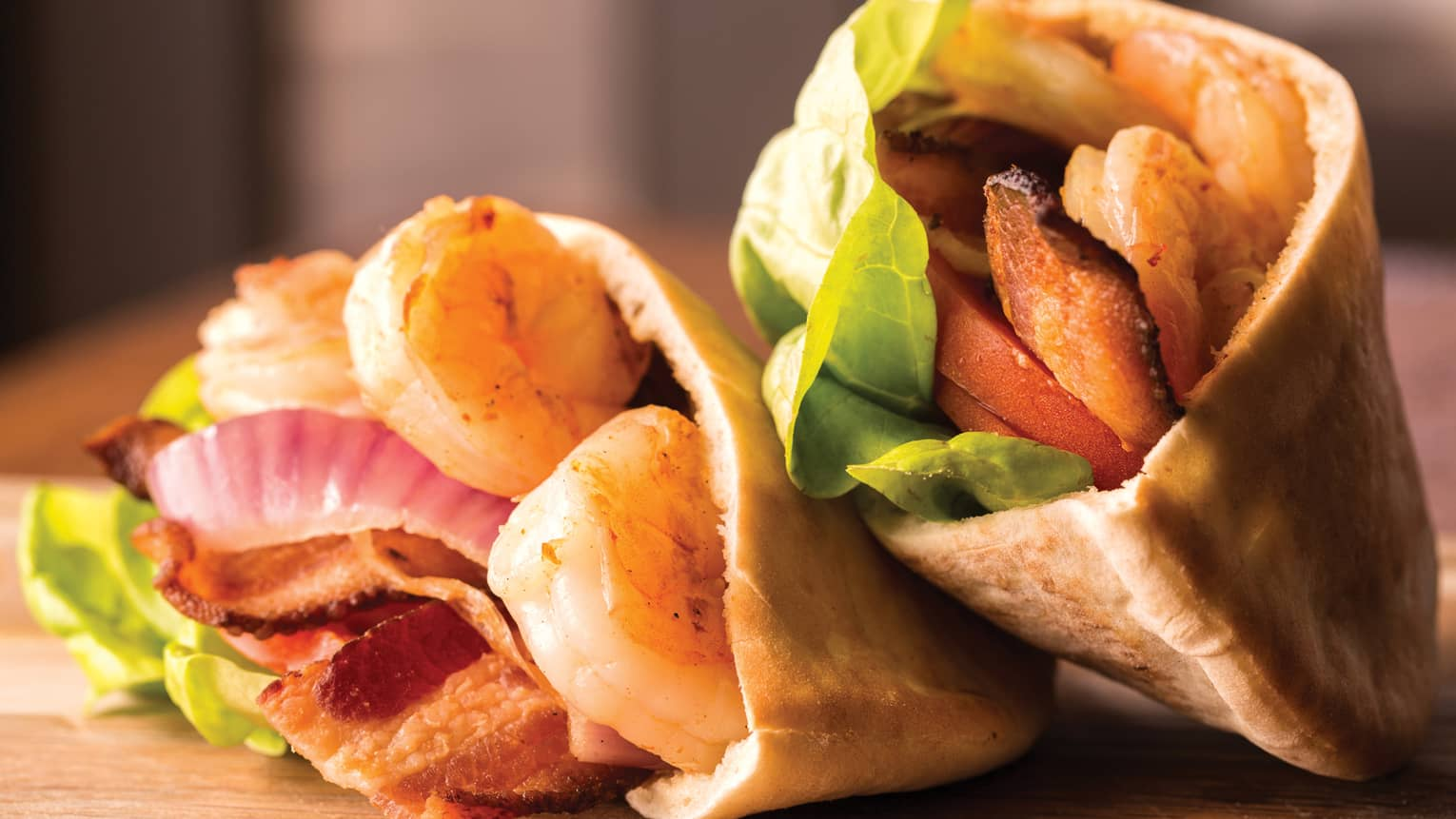 Hulopoe Bay Prawn B.L.T., shrimp, bacon, lettuce and tomato in pita wraps
