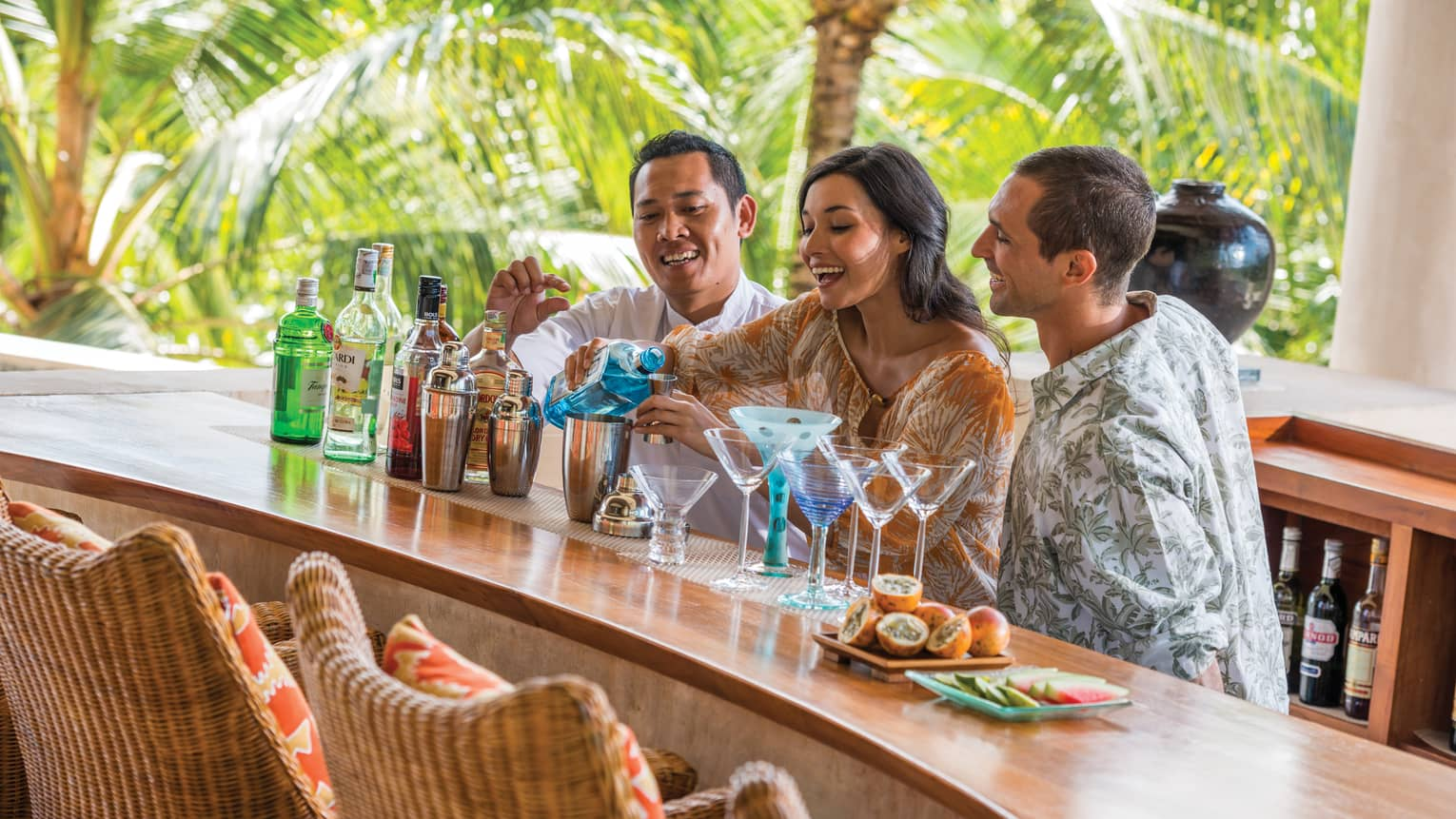 Guests learning how to mix drinks at a cocktail class in Bali