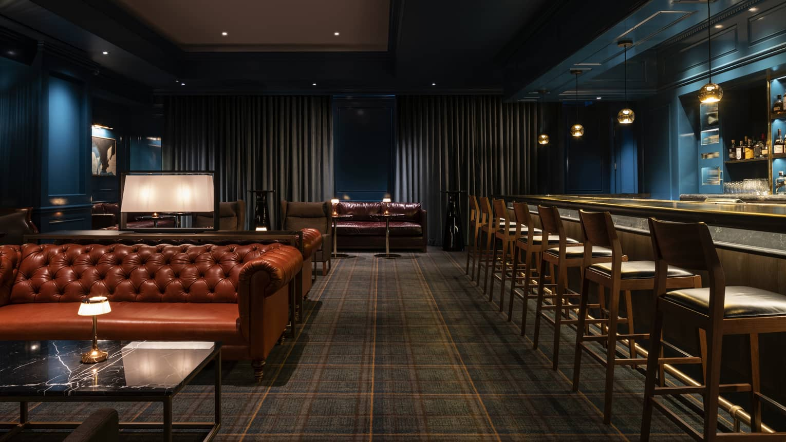 A dimly lit bar is ready for guests at Four Seasons Westlake Village