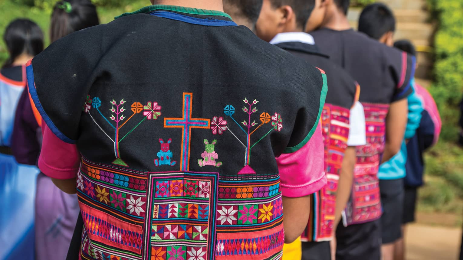 Close-up of colourful textiles on clothing made by hill tribes