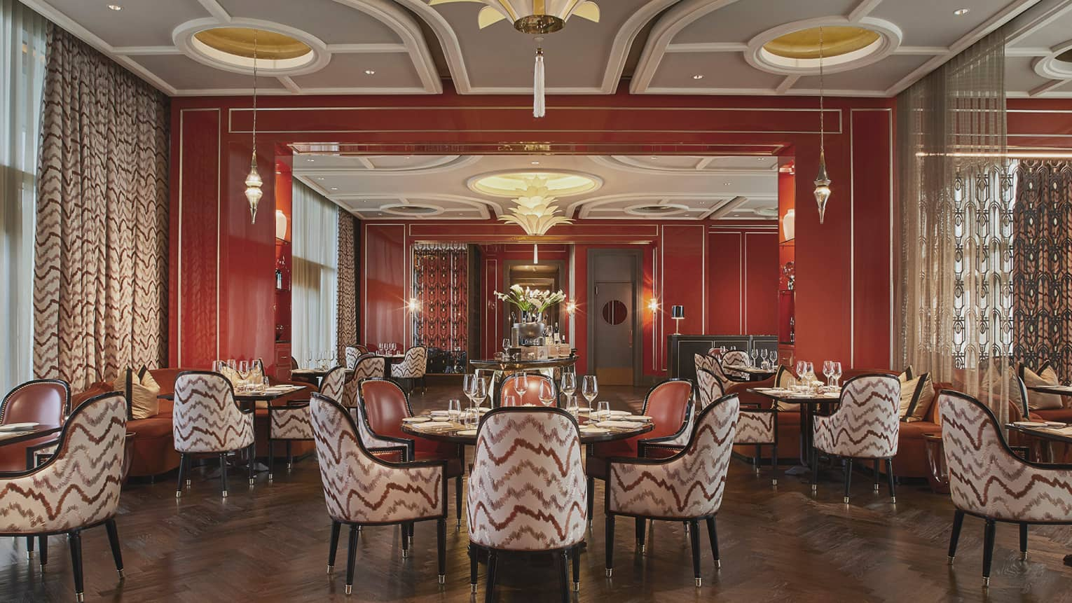 Alto restaurant dining room, each round table has four arm chairs, stylish geometric paterns