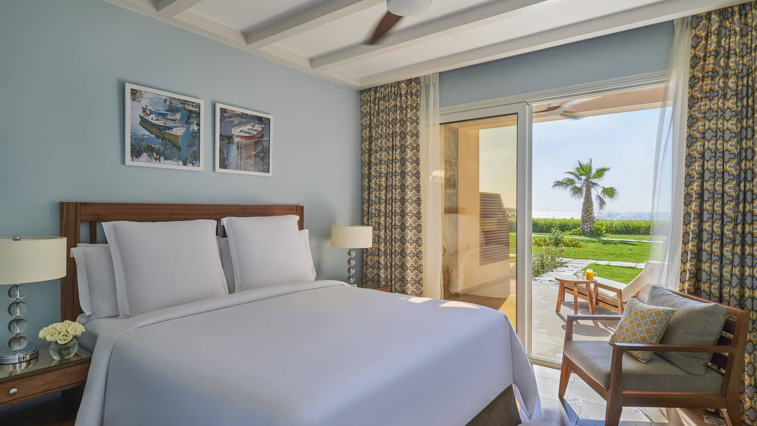A freshly-made bed in the beach suite overlooking the marsh