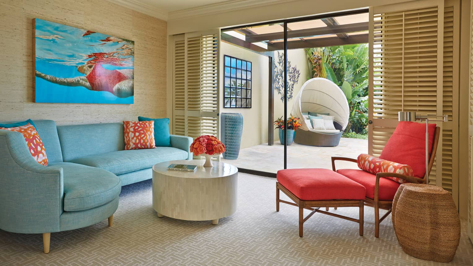 Lokelani Suite master bedroom sitting area near private outdoor patio