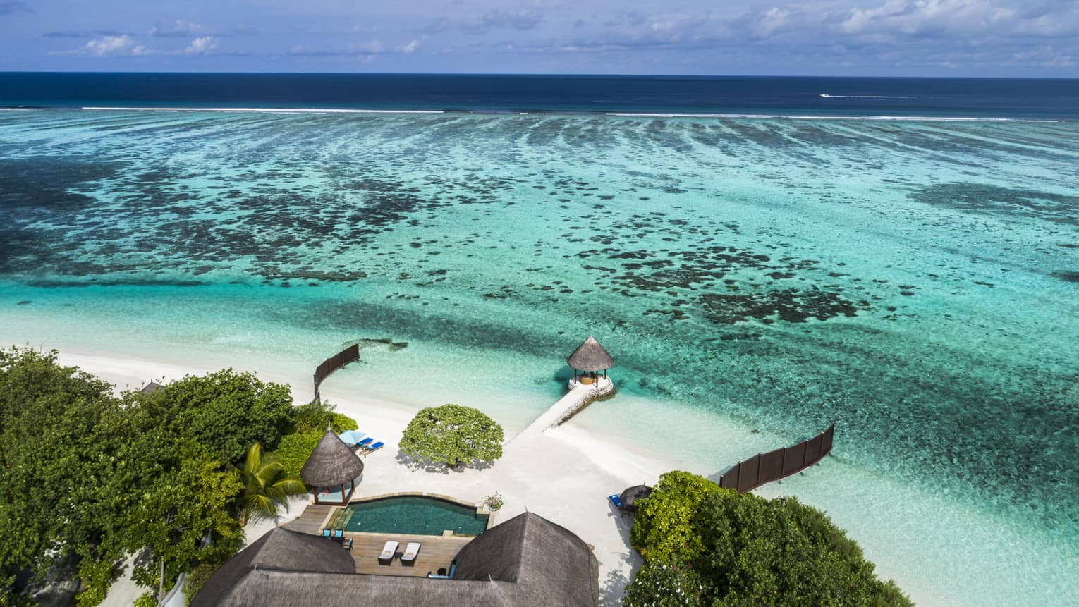 Aerial view of the Two-Bedroom Royal Beach Villa and its private beach in the Maldives