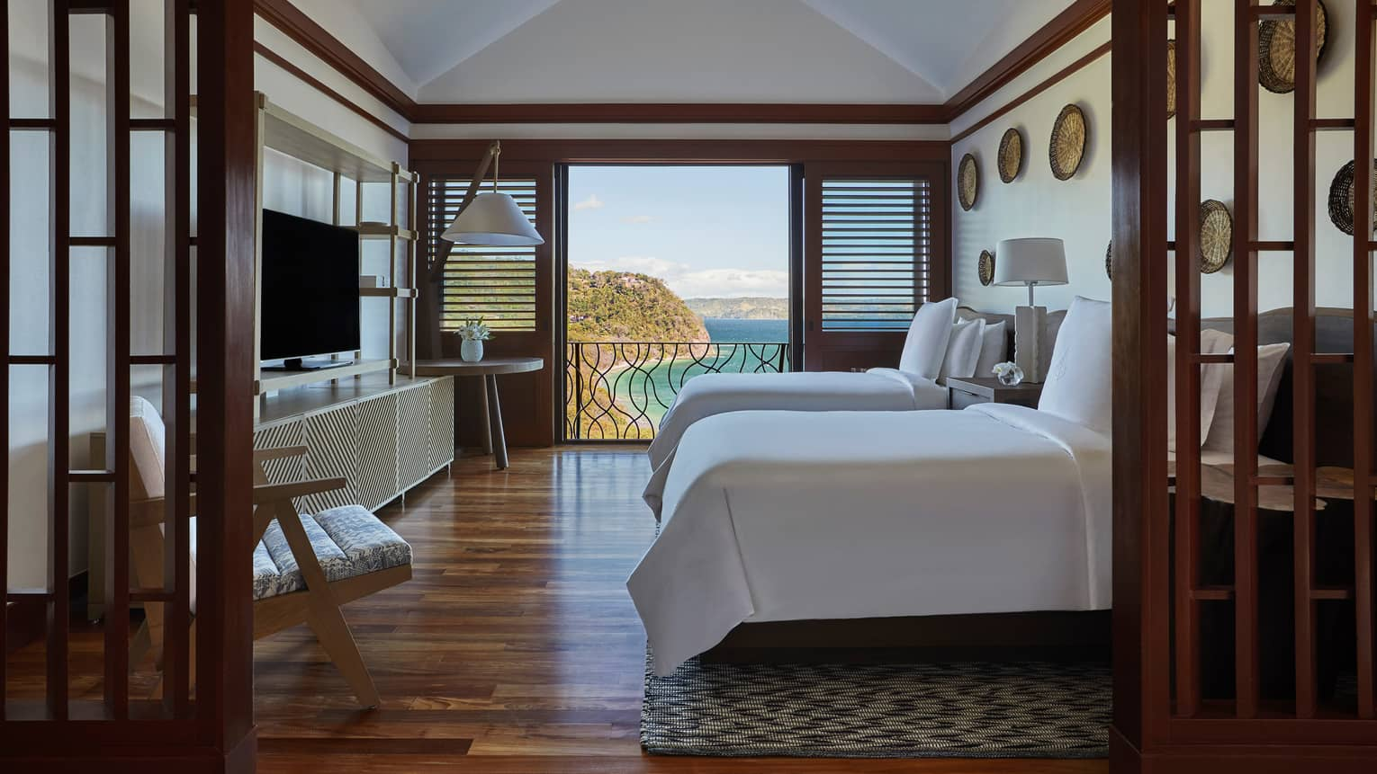 Canopy Suite Double Beds with Open Door Views of the Ocean