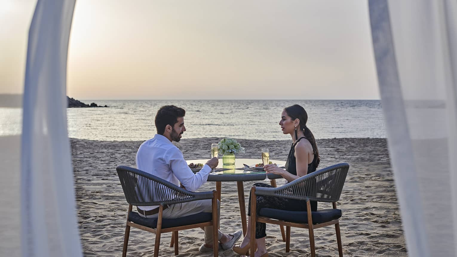 A couple has a romantic dinner for two on the beach at four seasons alexandria