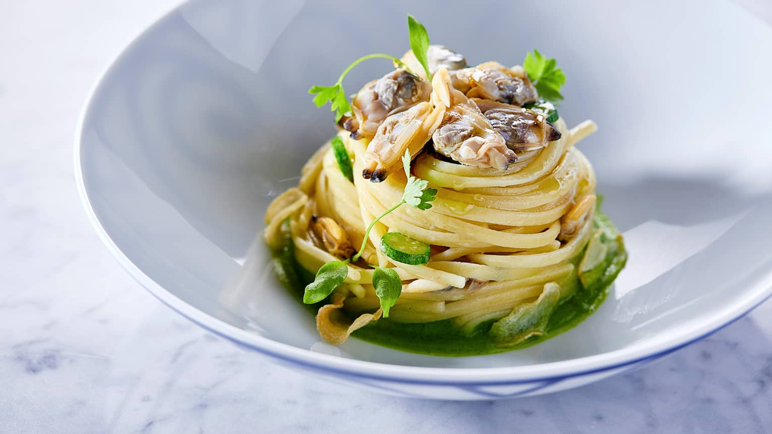 Linguine alle Vongole with pasta noodles piled high, fresh clams