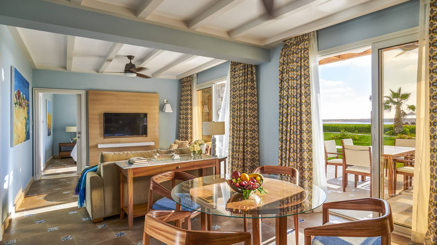 A brightly-colored beach suite overlooking the marsh at four seasons hotel alexandria