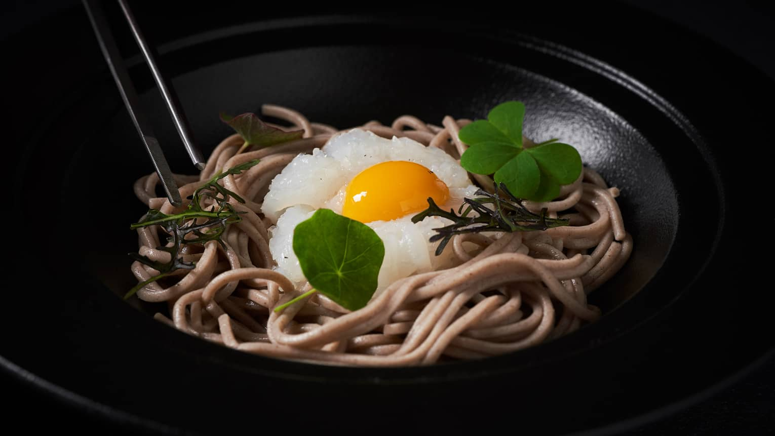 Buckwheat spaghetti with ika somen calamari, fish broth, quail egg yolk and summer truffle