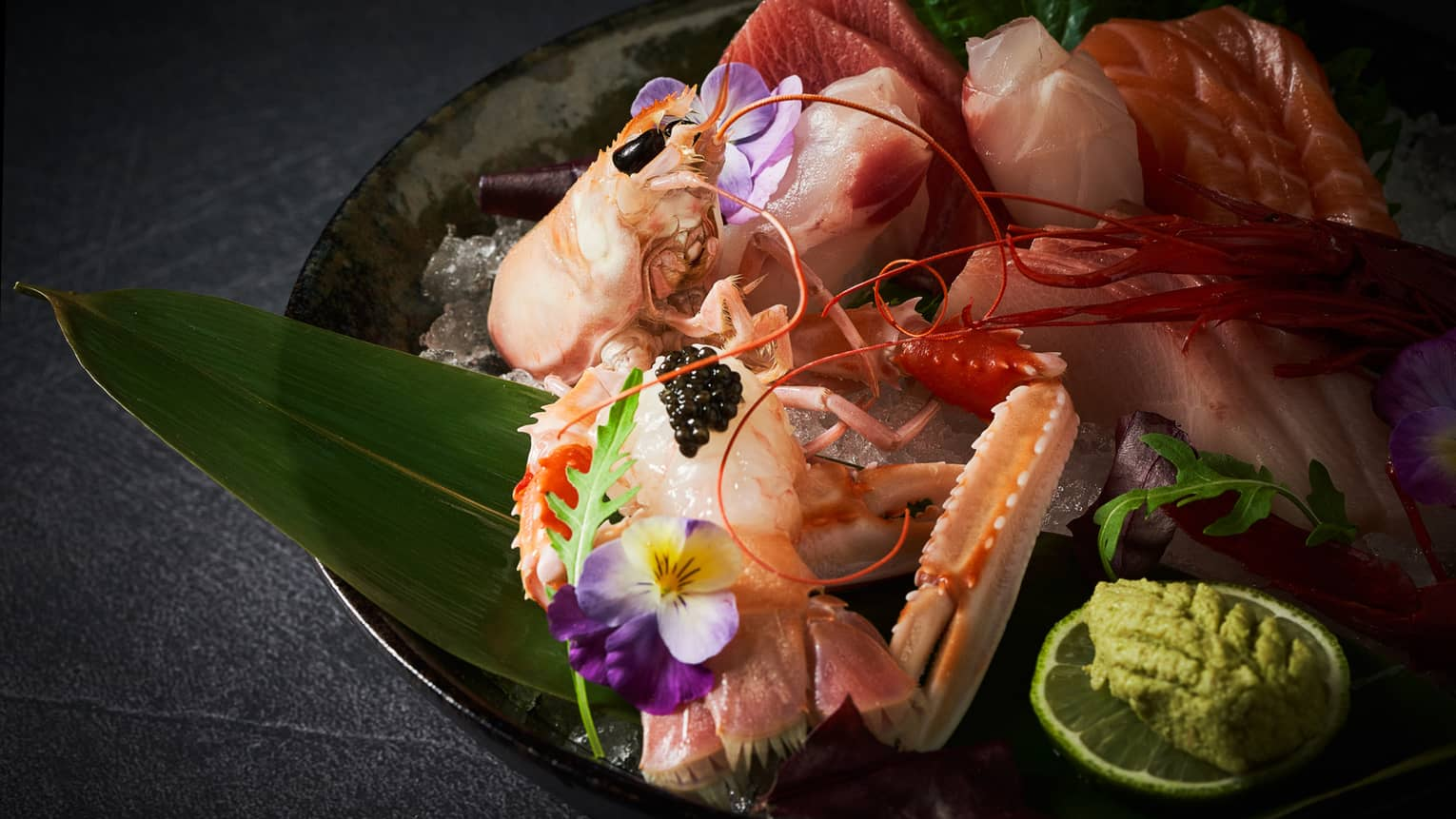 A sashimi selection served with wasabi and caviar