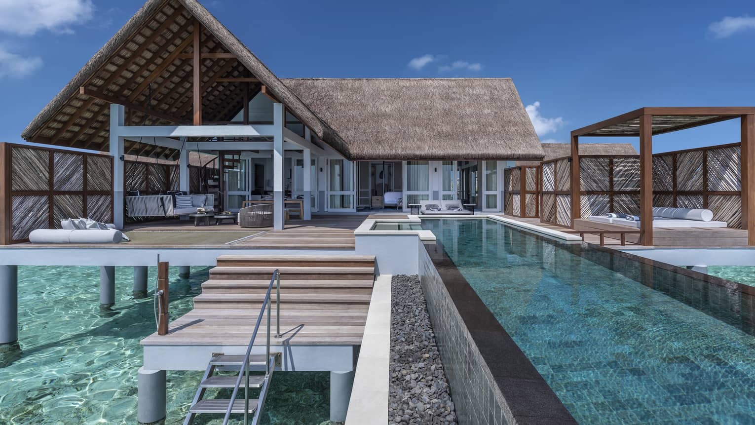 Over-water villas with private pools and furnished decks
