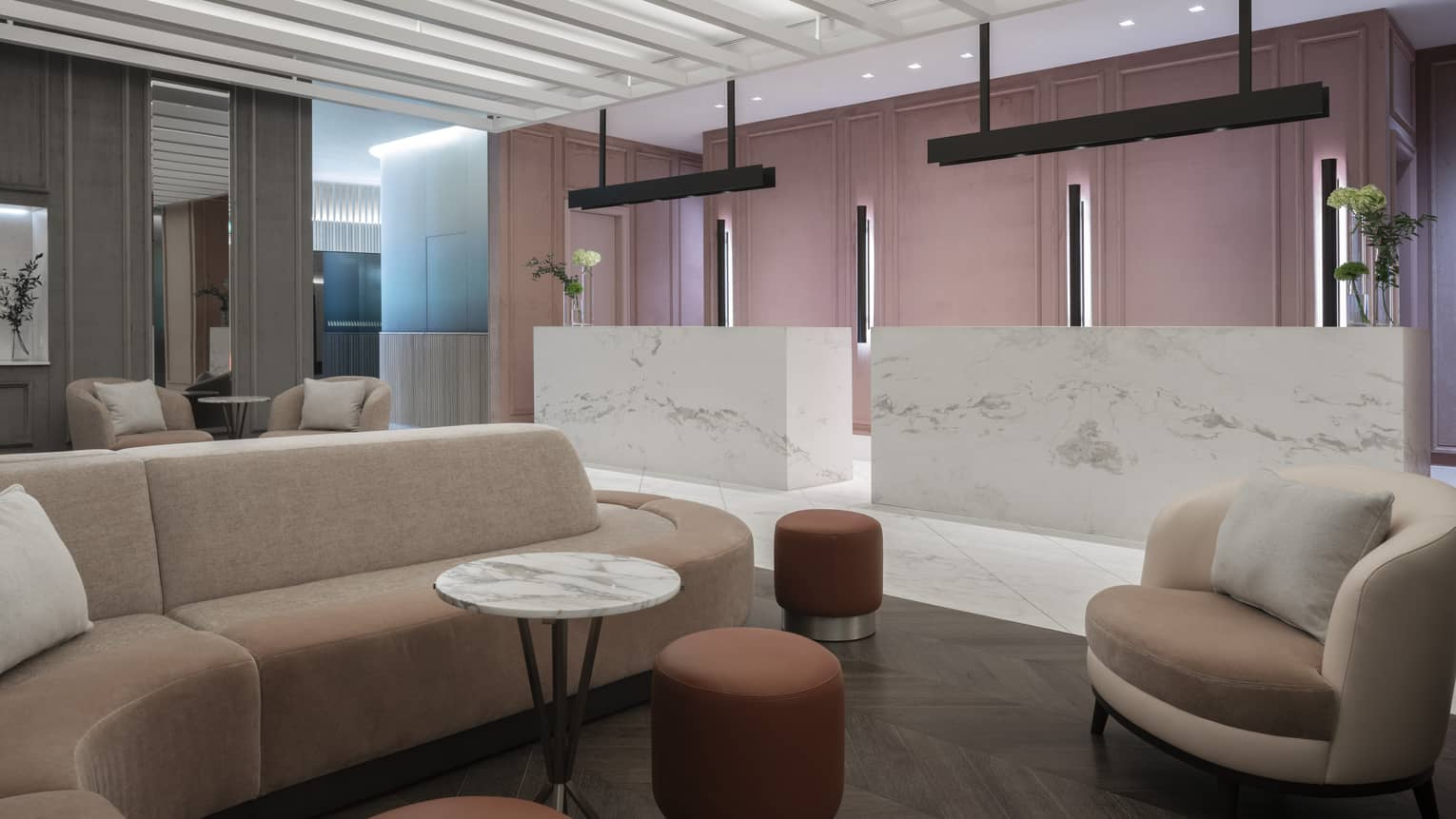 Social area in lobby with marbled desks, modular sofa, chairs, marble table, ottomans