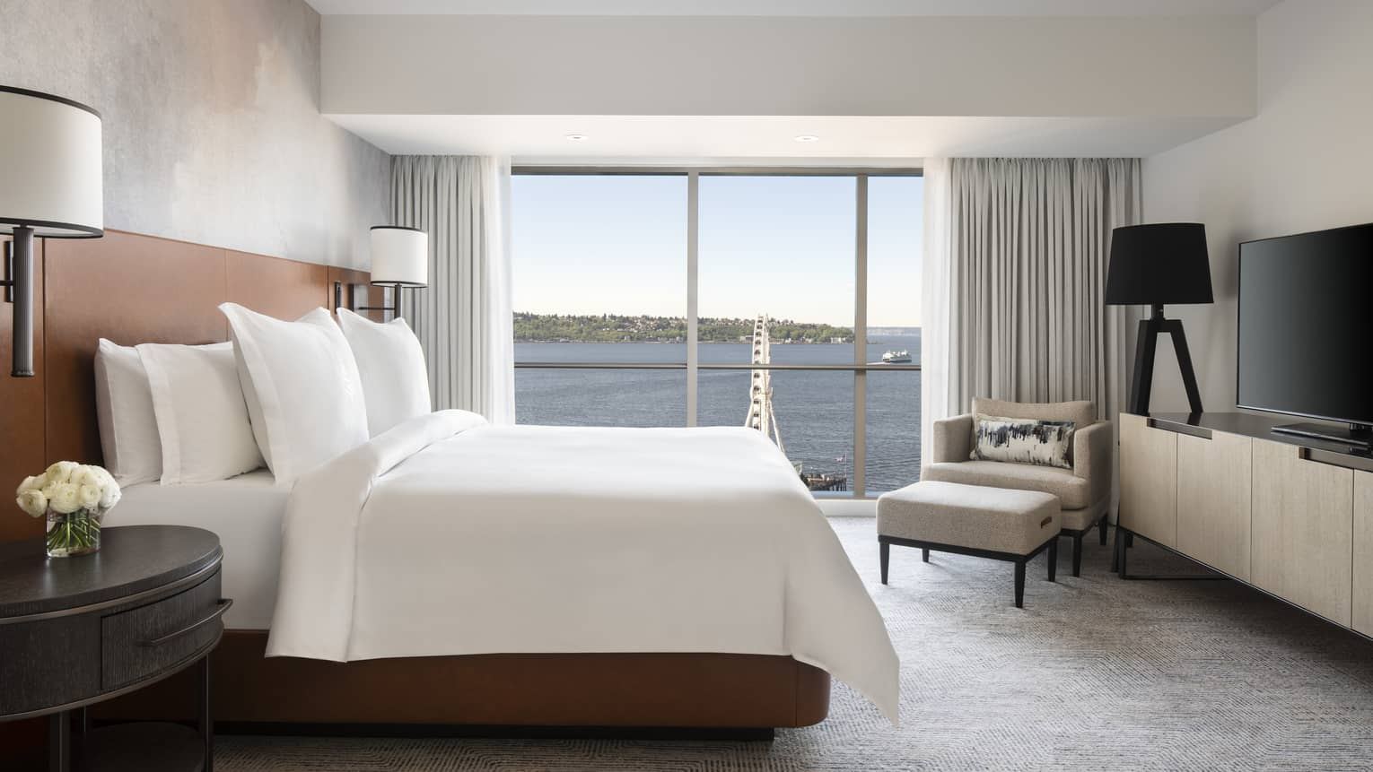 The Deluxe Elliot Bay Suite overlooks the Seattle Great Wheel