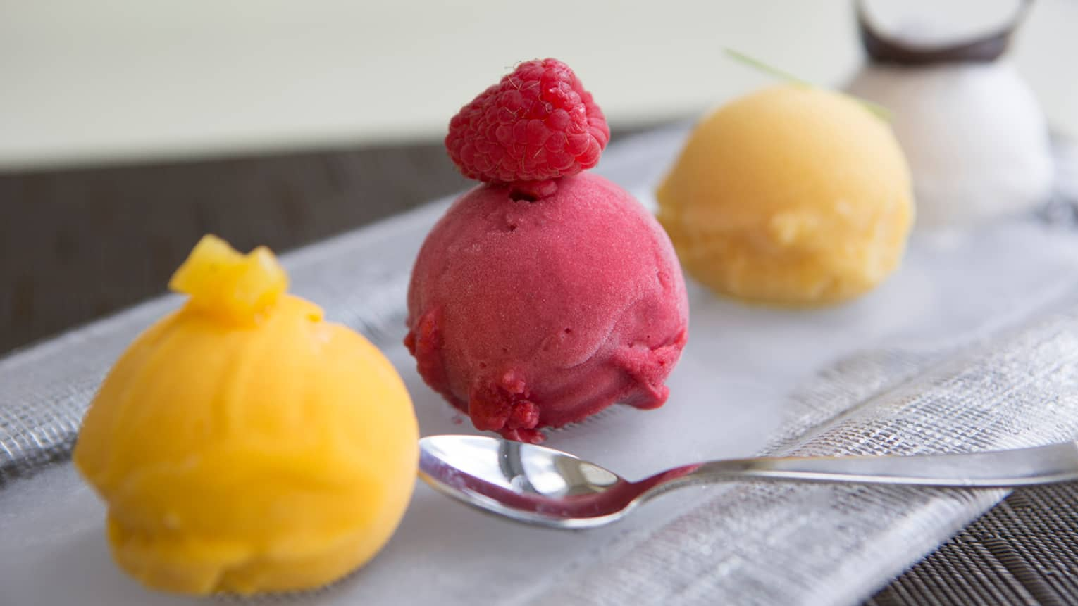 Scoops of fruity sorbet arranged on platter