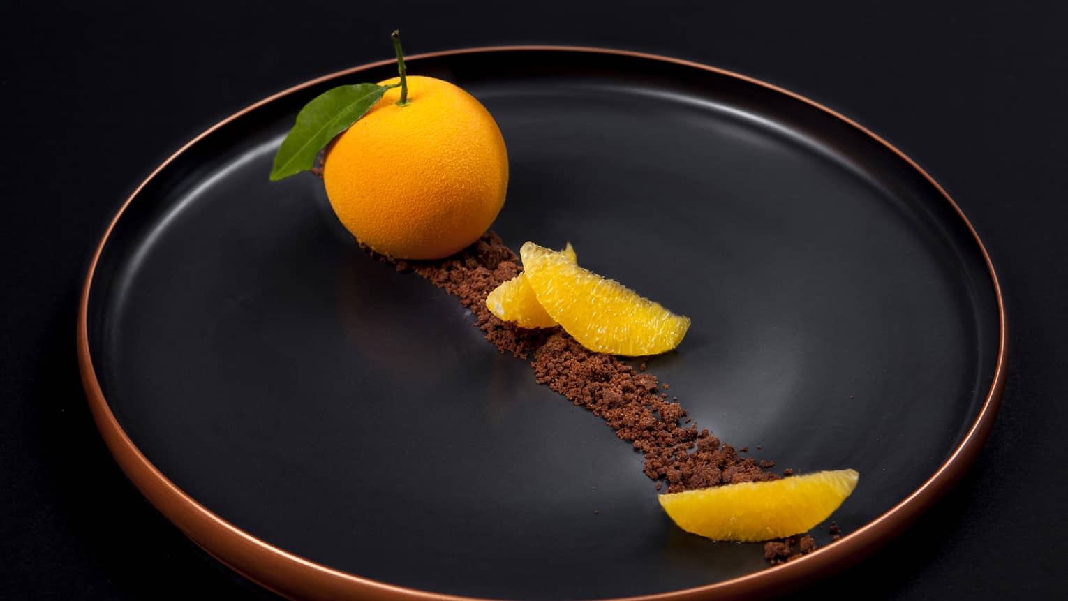 The Orange Signature Dessert served with cinnamon