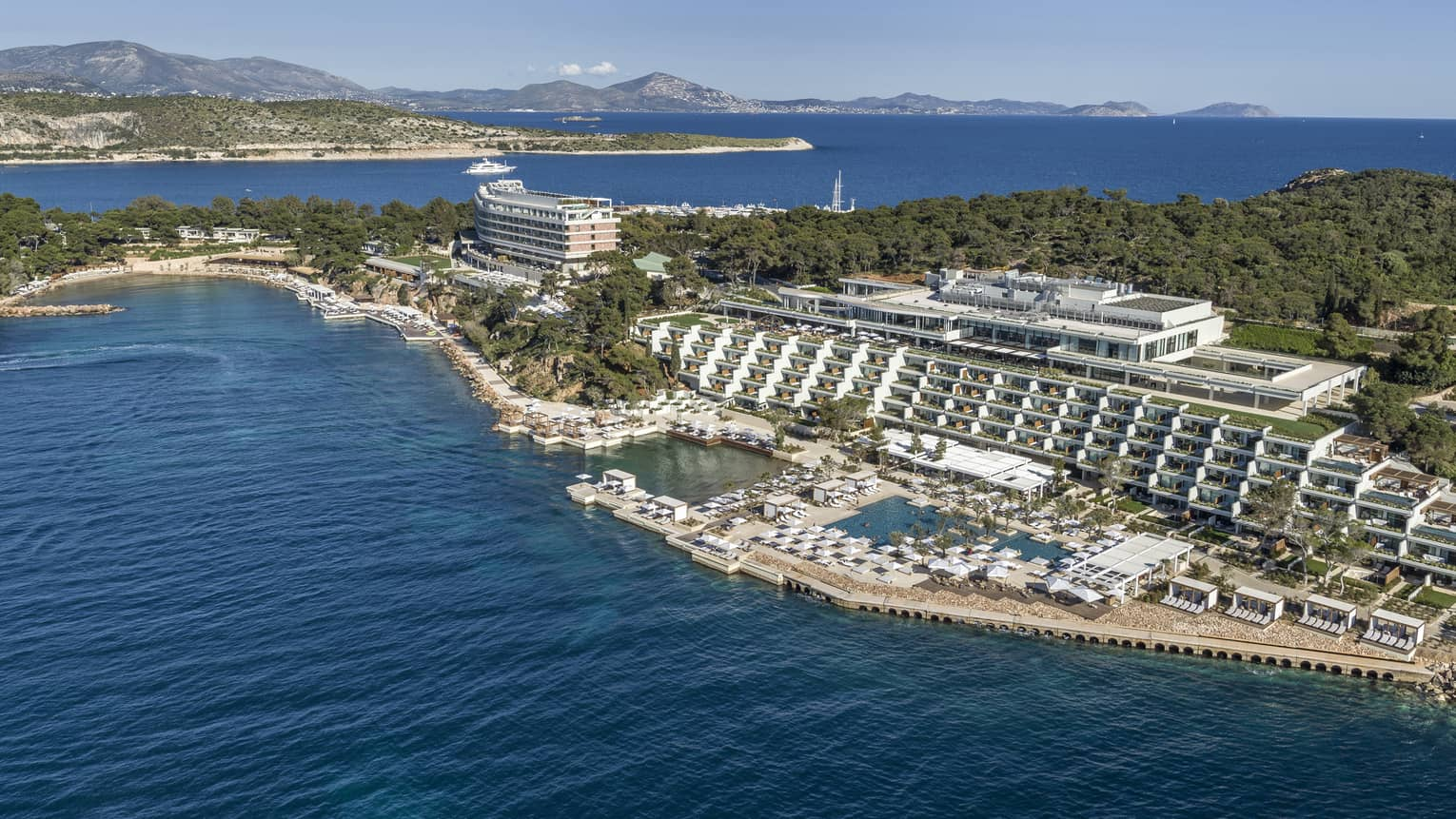 Sweeping aerial view of Four Seasons Astir Palace Hotel Athens along waterfront