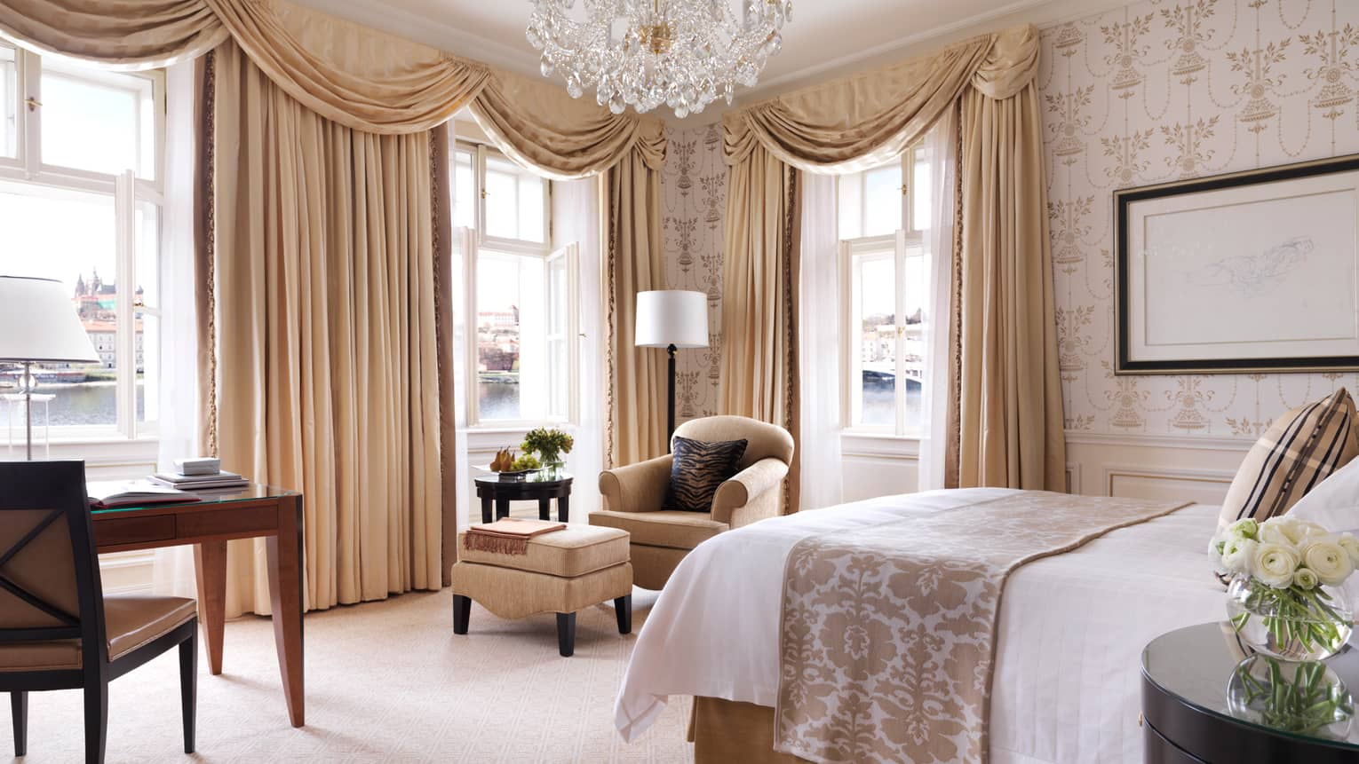 Premier Room bed, desk, chair, cream-and-gold Old European decor, long curtains, crystal chandelier