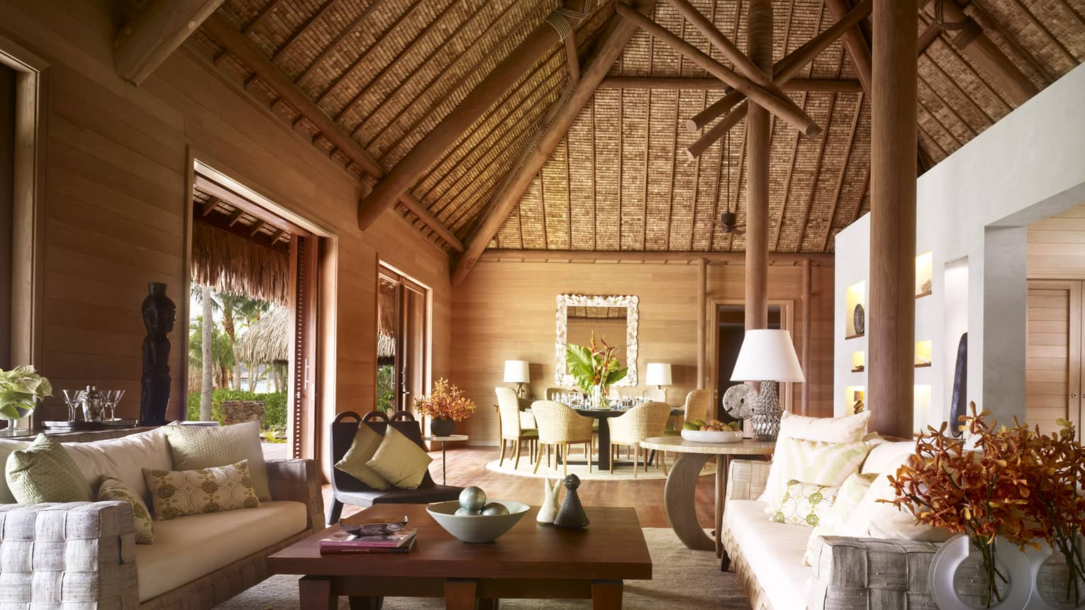 Large, bright bungalow with thatched cathedral ceiling, white sofas, Polynesian art
