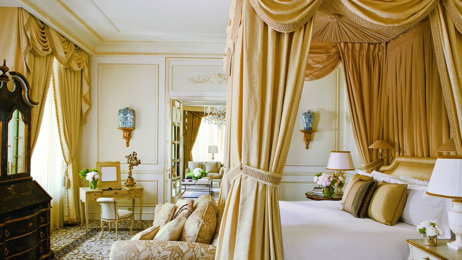 Elaborate Royal Suite, gold upholstery, canopy bed and curtains