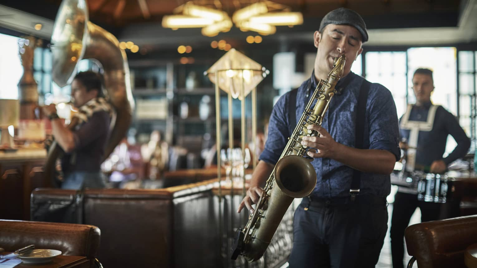 A live jazz band member plays the saxophone at Butcher & Still