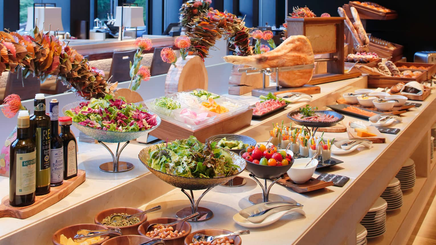 Brasserie breakfast buffet with bowls of fresh fruit, salads
