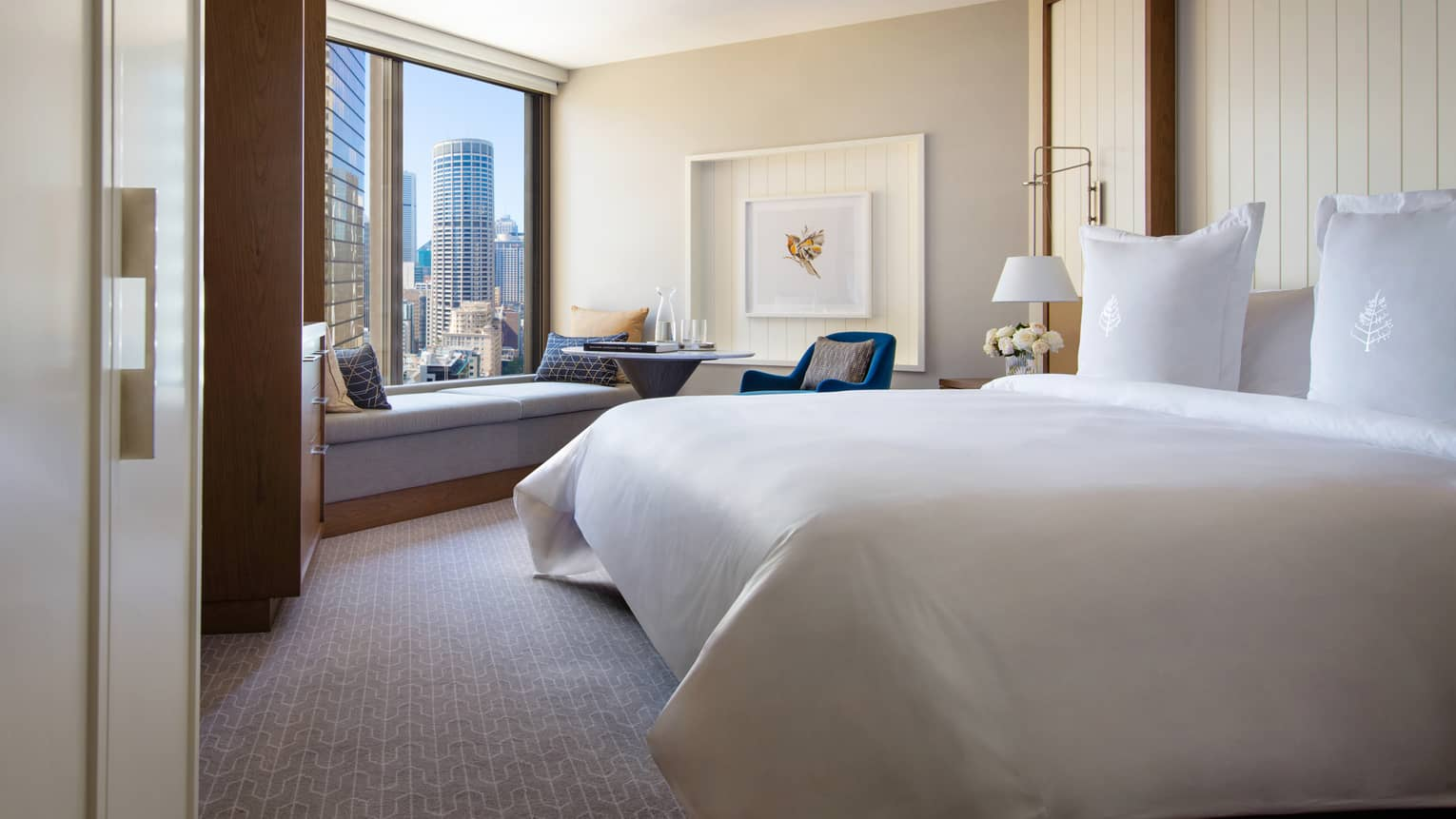 Hotel room with king bed and views of downtown Sydney