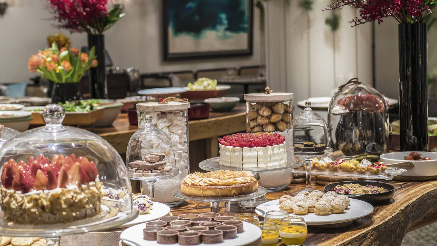 An arrangement of a variety of decadent desserts including cakes, tarts and soufflés