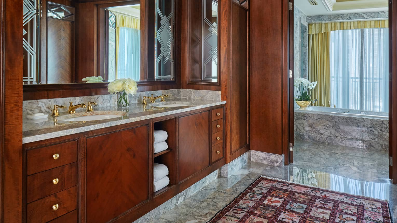 State Suite marble bathroom, bath, dark wood vanity with double sink