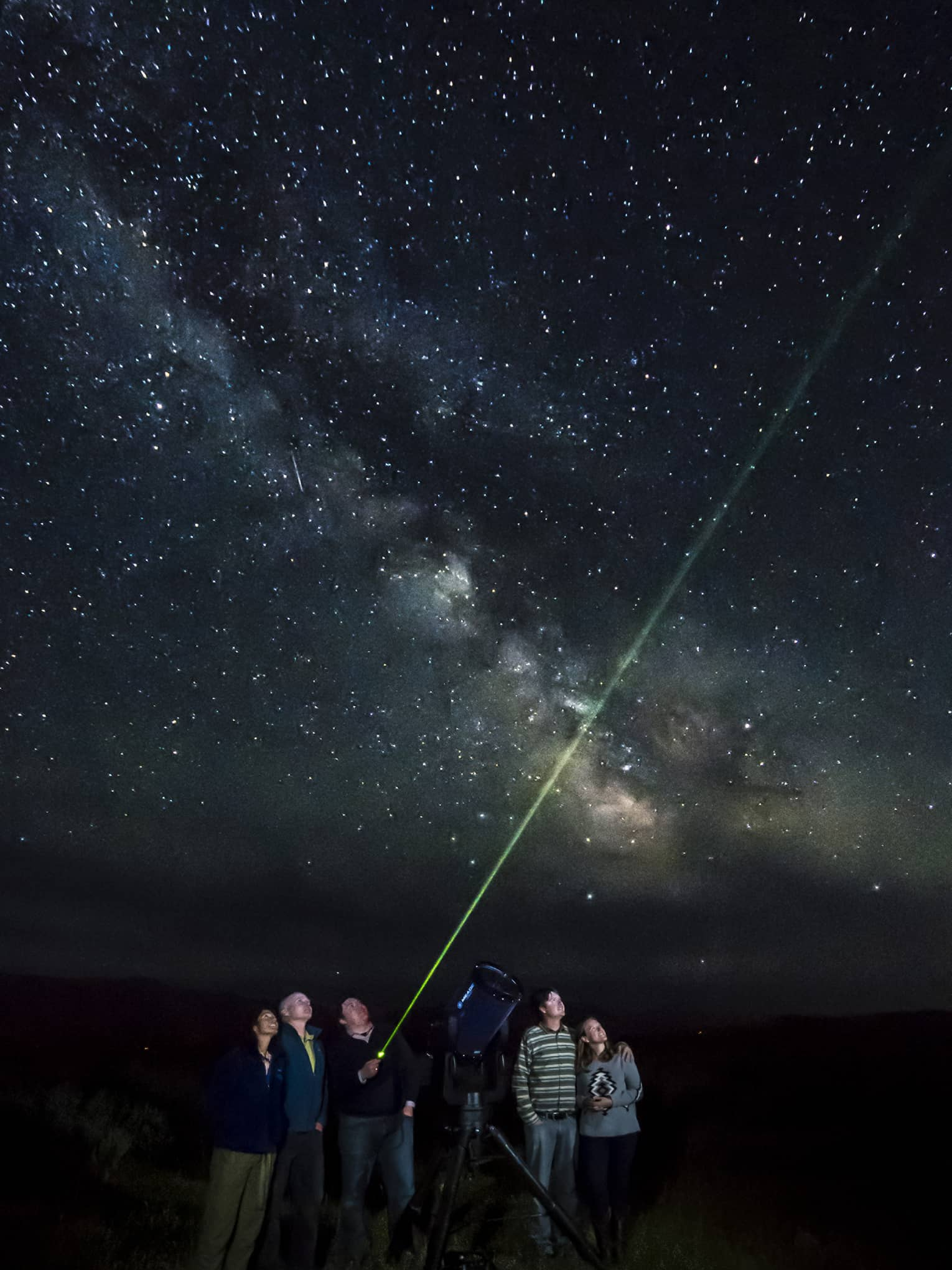 guests stargazing together