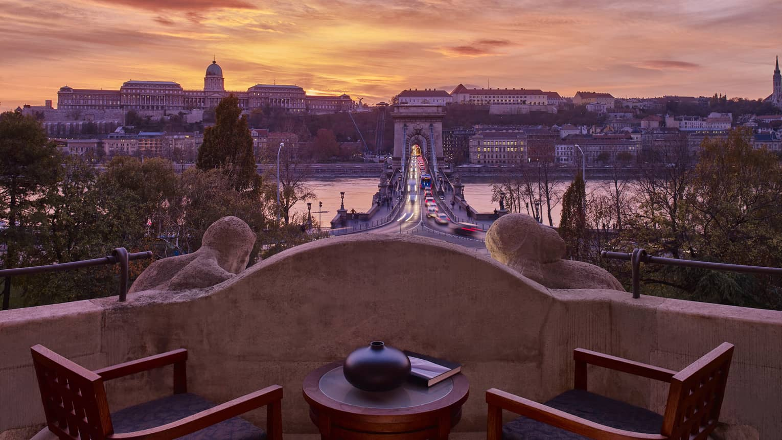 Royal Suite stone balcony with Danube River and Budapest view at sunset