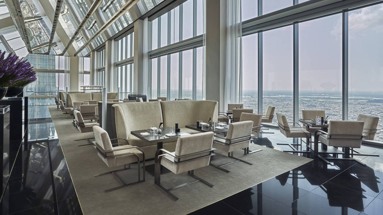 A well lit lounge area in the Skyhigh Lounge overlooking the cityscape.