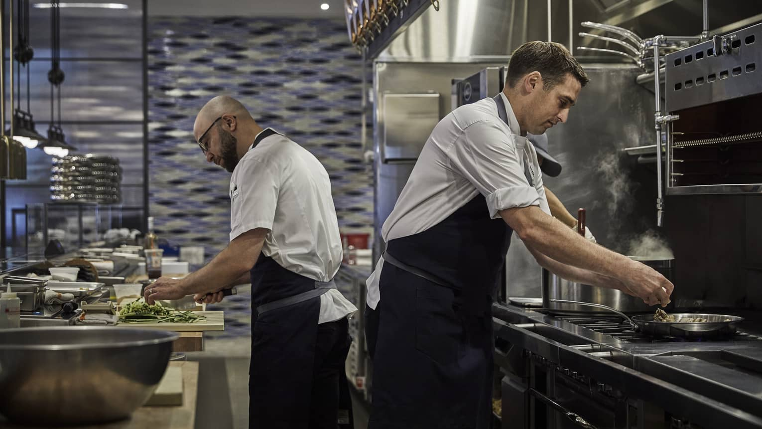 Chefs prepare meals in the kitchen of Four Seasons Philadelphia