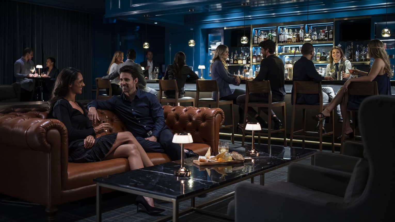 Middle-aged couples socialize over drinks at Prosperous Penny