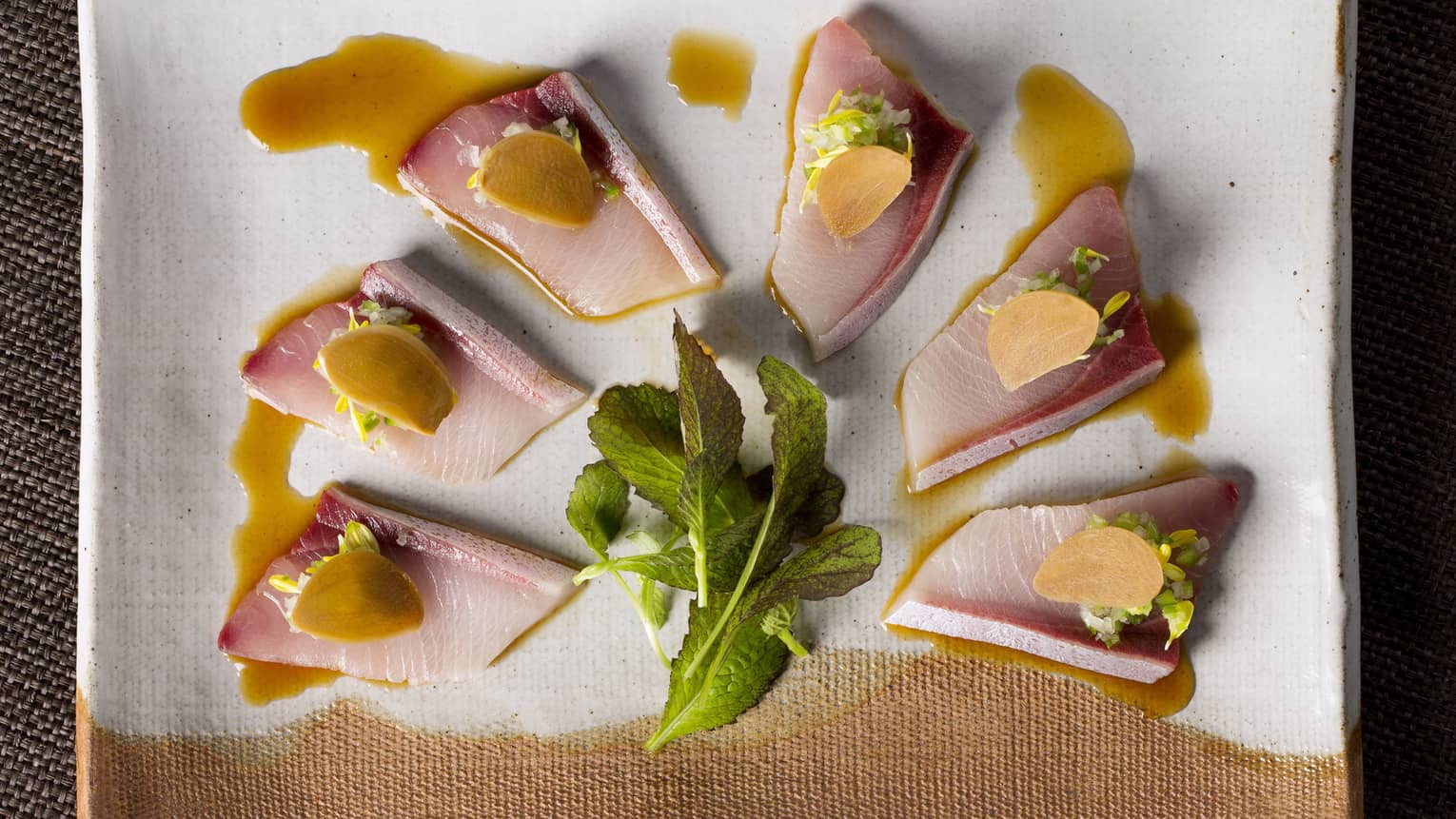 Sliced yellowtail with green chilli relish, ponzu and pickled garlic